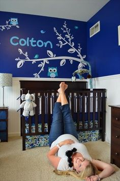 love the maternity pics in the babys room!    (But good God almighty that blue is BRIGHT!  Poor kid'll never get to sleep. )