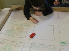 Draw a community with streets for cars to drive on.