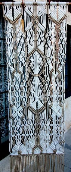"""Made to order! Hand made wall hanging decoration, made in macrame technique.  Made of synthetic materials. White and pearl colors. Almost same from both sides, so it can bee used as a room divider as well. Measurements are: 22"""" x 56""""."""