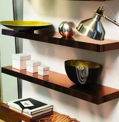 A lacklustershelfgets a shot of glamour with the exact application of copper contact paper (or gold or silver, if you prefer). The simple and clean lines of the shelf make for an ideal application but if doubt your handiwork, the same look can be achieved with metallic spray paint.