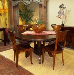 Rustic Round Dining Table hand crafted from Reclaimed & Teak Dining Chairs at Gado Gado .