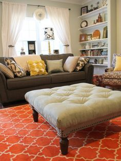 Colorful Living Room... Looks comfy and cozy but still bright and happy!