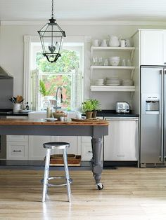White cabinets and shelves.  Gray island.