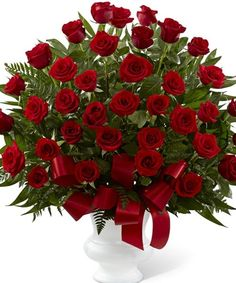 The Soul's Splendor Arrangement is a rich display of the love shared throughout the life of the deceased. Brilliant red roses are elegantly displayed in a white designer plastic urn and accented with lush greens and red satin ribbon Rosen Arrangements, Red Rose Arrangements, Funeral Flower Arrangements, Amazing Flowers, Red Flowers, Red Roses, Beautiful Flowers, Red Rose Flower, Church Flowers