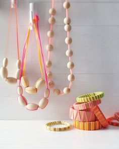 easy to make necklaces and bracelets using plastic lanyards and wooden beads
