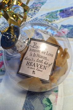 The ornament with big Terry's flowers from the funeral and a quote I made for my 2nd family the pannells :) they turned out great!!!