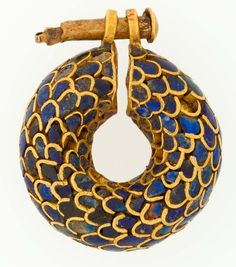 Earring Period: New Kingdom, Ramesside Dynasty: Dynasty 19 Date: ca. Geography: From Egypt Medium: Gold, lapis lazuli Dimensions: Diam. cm in) Credit Line: Gift of Helen Miller Gould, 1910 Accession Number: Ancient Egyptian Jewelry, Egyptian Art, Ancient Egypt Fashion, Egyptian Costume, Egypt Jewelry, Jewelry Art, Gold Jewellery, Crystal Jewelry, Diamond Jewelry