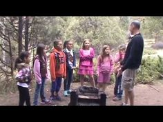 """Brownies from Aurora, Colorado created this video as their Take Action project for the """"A World of Girls"""" program.  They were really upset by last year's wildfires and wanted to change the story of wildfires in Colorado. They learned a lot about wildfires — they even went on a field trip to a wildfire fire station! The girls wanted to tell a story about how anyone can stop a fire from starting, just by keeping someone from starting a camp fire — this video was what they came up with."""