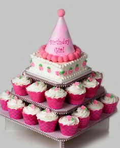 Petite Square Cupcaketree (holds 40 cupcakes & cake ) $12- each tier cupcakes with pink and teal paper and cream icing......top cake with cream icing and either pink and teal monogram or sparkly large E