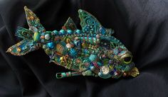 The Fantastic Bead Mosaics Fish Series The Blue Wahoo. $250.00  Maybe a dad could cut a salmon or orca out of plywood and we could mosaic that.  A project like this would appeal to many people and not just the parents of the class that does it.