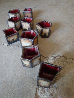 Red teacups.    Olia Lamar