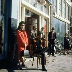 1960's. Jazz club The Cotton Club on the Nieuwmarkt in Amsterdam. The Cotton Club first opened its doors in 1940, as Café Smit, after its owner Annie Smit. After the war, Suriname immigrants and African American soldiers introduced jazz and marijuana into the Amsterdam scene. Annie Smit soon fell in love with Suriname trompet-player Teddy Cotton and changed the name of the bar into Cotton Club. #amsterdam #1960 #Cottonclub