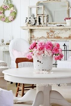Love all of the white with a pop of color. Also love the textures and shabby chic feel.
