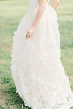 Sure we may be in the sweltering heat of summer, but that doesn't mean spring if far from our minds. Because if this lovely inspo from Elizabeth Fogarty is any indication, said blooming season is al. Elegant Wedding Dress, Floral Wedding, Wedding Dresses, Flower Fashion, Beautiful Bride, Bridal Style, Bridal Gowns, Wedding Inspiration, Wedding Ideas