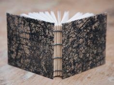 Hand Bound Mini Sketchbook - Coptic Stitch - Journal / Notebook - Black Batik - Small - Pocket Journal / Travel Journal / Diary by TheEloiseBindery on Etsy https://www.etsy.com/uk/listing/273714580/hand-bound-mini-sketchbook-coptic-stitch