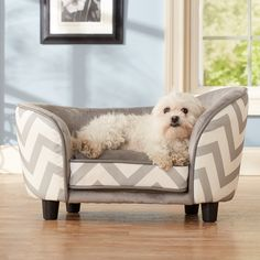 Enchanted Home Pet furniture eases your pet into a luxurious cushion that engulfs them in complete comfort and warmth. This trendy sofa bed features a chevron print and sturdy wooden legs to keep your dog relaxed and in style.