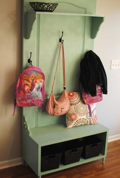 A hall tree made out of a door, a wood box and a shelf.  Adorable.