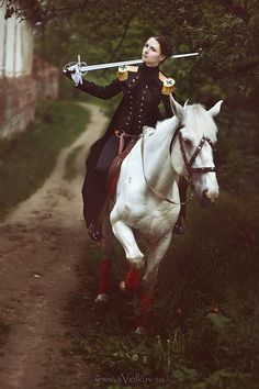 commanderbishoujo:  goddessofcheese:  gdfalksen:  Girl + Uniform + Horse + Sword = what is there not to like about this?  Bisho Alert