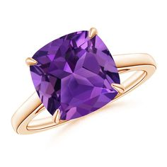 Make a statement with this A deep purple cushion amethyst is claw prong set on this 14k rose gold cocktail ring. The gallery of this vintage amethyst ring exhibits elegant scrollwork. from Angara.com. Explore a fascinating array of designs