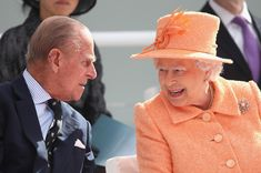 Queen Elizabeth II chats to Prince Philip, Duke of Edinburgh as she takes part in the naming ceremony for the P&O Cruises vessel at Ocean Cruise Terminal on March 10, 2015 in Southampton, England. Britannia will carry over 3647 passengers and at 141,000 tons she will boost P&O's cruise ship capacity by 24%.