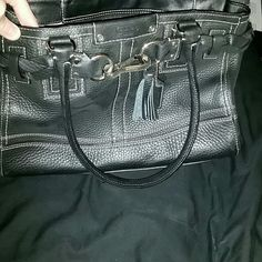 Coach Hampton Pebbled Leather Tote black Classic black Coach tote with pebbled leather, a braided belt around the top, a Coach tag, and a tassel. Very gently used, it's not the right size for all my stuff. Black (eye makeup?) mark on inside lining, but otherwise clean with no scuffs or major signs of wear. Two inside phone pockets and an inside zip pocket. Size is around 12 by 8.5 and about 4.5 deep. Please comment with further questions! I will also try to add some better pics soon, my…