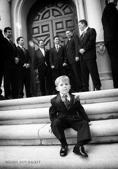 I saw this very serious ring-bearer sitting on the steps of the church before the ceremony. He stared at my camera as I lifted it to take his photo...his expression never changing. I stopped when I saw no reaction and asked if he planned on smiling today. He said no. He kept his word. Photo: Melissa Ann Bagley
