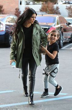 Casual style: Kourtney Kardashian wore an olive coat as she was seen with son Mason in Los...