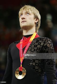 Evgeni Plushenko of Russia stands on the podium after winning the gold medal in Men's Figure Skating following the Men's Free Skate Program Final during Day 6 of the Turin 2006 Winter Olympic Games on February 16, 2006 at the Palavela in Turin, Italy. Stephane Lambiel of Switzerland won the silver medal and Jeffrey Buttle of Canada won the bronze medal.