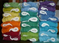 i love big stacks of simple diapers. these are hand dyed converted prefolds by Tinkle Traps.