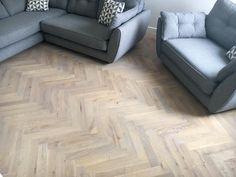 Solid Oak. White washed solid wood herringbone parquet floor.