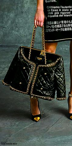 I don't normally like things with names all over. But this is an exception. Moschino prefall bag.