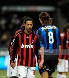 Zlatan Ibrahimovic of FC Internazionale (R) and Ronaldinho of AC Milan look on during the 'Serie A' 2008-2009 match, round 24th, between Inter Milan and Milan, at the 'Giuseppe Meazza' stadium in Milan, Italy.