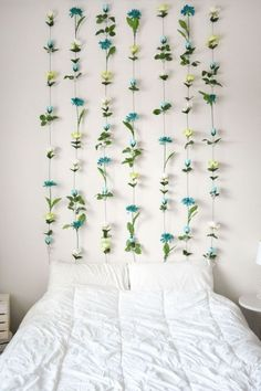 This is one of the most dimensional summer decorating ideas. #hangingflowers #stringflorals