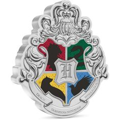 Add a touch of magic to your collection with this 1oz pure silver coin of the Hogwarts™ Crest. The crest bears an 'H' for Hogwarts surrounded by the traditional colours and mascots of the four houses: a lion on red for Gryffindor, a snake on green for Slytherin, a raven on blue for Ravenclaw and a badger on yellow for Hufflepuff Hogwarts Crest, Ravenclaw, Draco, Silver Coins, Harry Potter, Silver Quarters, Dragonair