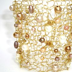 Unique Pearl Statement Jewelry. Red Carpet Big Wide Hand Knit Arm Cuff. Bracelet gold, ivory pearls and crystals. $150.00, via Etsy.