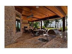 It would be very nice to gather on the porch with friends and family while making pizzas in the pizza oven.
