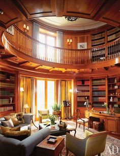 """Isn't this a beautiful home library! It """"makes vague reference to the classical Ionic order,"""" Katherine Newman says of the library in a postmodern Toronto house she designed with architectural designer/builder Peter Cebulak. The room's finely carved capitals are complemented by a great number of noteworthy antiques, among them a circa 1790 satinwood worktable. #homelibraries"""