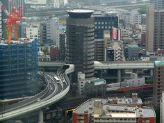Hanshin Expressway system in the Japanese city of Osaka is a head turner, it goes right through the building.