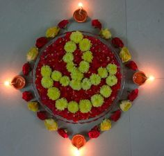 Diya arranged with flowers..