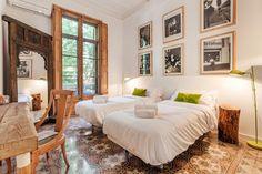 Bedroom with floor tiles in a Barcelona apartment