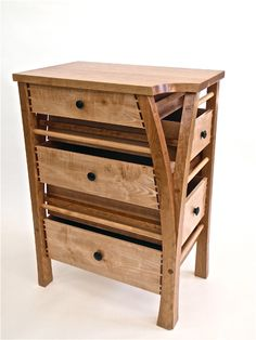 Corner chest of drawers Material: Cherry, Maple