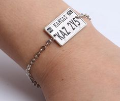 """""""Driver picks the music, shotgun shuts his cake hole."""" - Dean Winchester Dean and Sam wouldn't want you to be caught without this awesome accessory! The Supernatural License Plate Bracelet is a replic"""