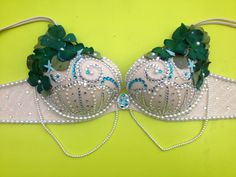 My DIY mermaid bra. Bought everything at a craft store and just added embellishments until I filled it up. Most of the pearls and ditties were actually stickers from the scrapbook section!  I used a glue gun :)total cost about $20. I had the bra already.