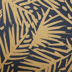 Shop caymen navy and gold palm traditional paste wallpaper. Modern meets tropical in this fresh leaf motif by Hygge and West. Designed exclusively for CB2, breezy gold strokes brush an impromptu pattern of tropical leaves on a field of rich navy.