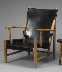 """Erik Gunnar Asplund. """"Göteborg Chair"""". Armchair with walnut frame. Upholstered in black leather. Produced by Cassina in 1983. Designed for Göteborg City Hall in connection with renovations in 1930s. [Lauritz.com]"""