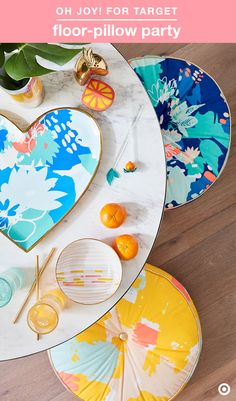 Round pillows can work as the perfect alternative to seating in a small space. These colorful Oh Joy! for Target pillows will brighten things up, and they're easy to tuck away. Set up some apps and refreshing drinks on the coffee table, and pull up some floor pillows—instant summer party.