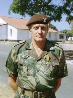 The insignia on his beret shows he's a Selous Scout. But his squared-away appearance & shoulder-boards suggests he's an officer, many who served in a rear-guard, administrative capacity. Simon Benford-Howe likely looked like this.