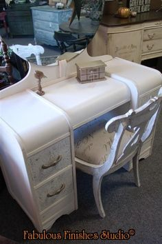 Stenciled drawer fronts on this gorgeous waterfall vanity!