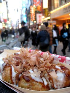 Takoyaki, or grilled octopus in a puff ball of dough, a favorite on the streets of Osaka!