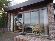 KormorantApartment in Franskraal – Cape Whale Coast This luxurious sea-front self-catering flat is attached to our family home, Kormorant, and ideal for two people